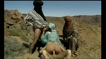 Three Of The Terrorists, The Taliban Rape A Brunette's Body