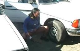 Sexy Brunette Pee Near A Car