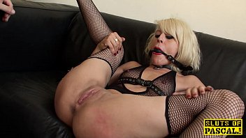 Blonde Chick With A Gag In Her Mouth She's Masturbating In Front Of The Camera
